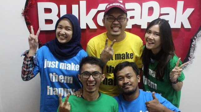 CEO of Bukalapak Achmad Zaky (middle)