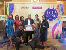 Burhan Noor Sahid (center), Head of Modern Retail & Branded Retail Channel Philips Lighting Indonesia exhibited Top Brand awards along with Philips Lighting Indonesia team after the award ceremony.