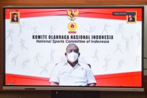 General Chairperson of the KONI Marciano Norman delivers press statement after attending a limited meeting on Preparation of the 20th PON in Papua through video conference, Tuesday (13/7) (Photo: Agung/PR)